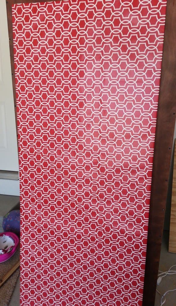 How to paint laminate furniture - back of bookcase covered in wrapping paper