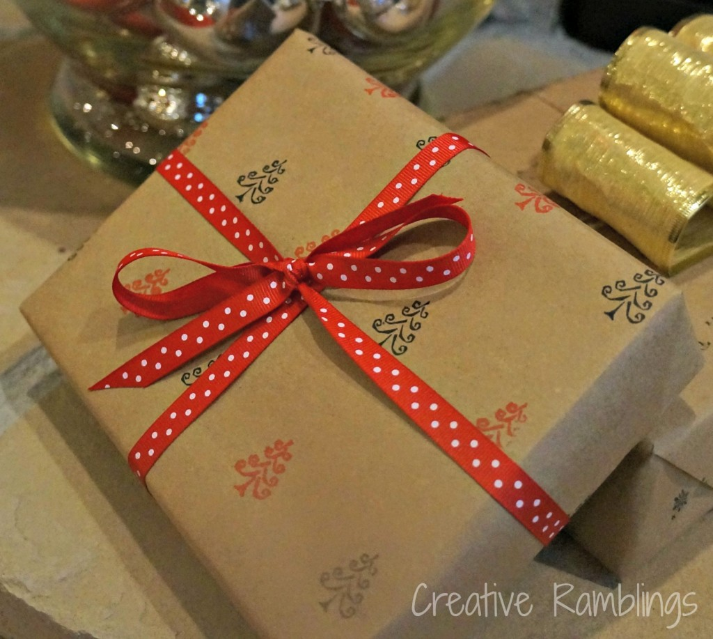 Red bow on tree stamped kraft paper