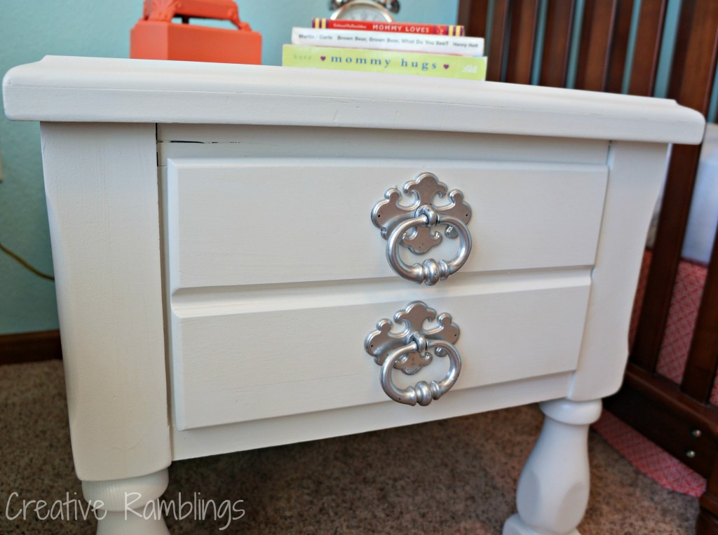white side table with silver handles