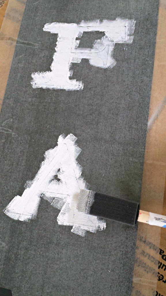 painting letters with a contact paper stencil
