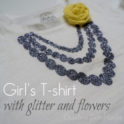 girls tshirt with glitter htv necklace and fabric flower