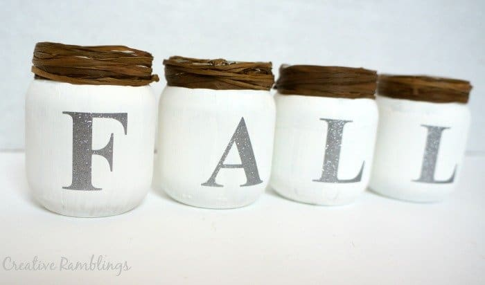 #fall baby food jars with white chalk paint, raffia, and glitter vinyl