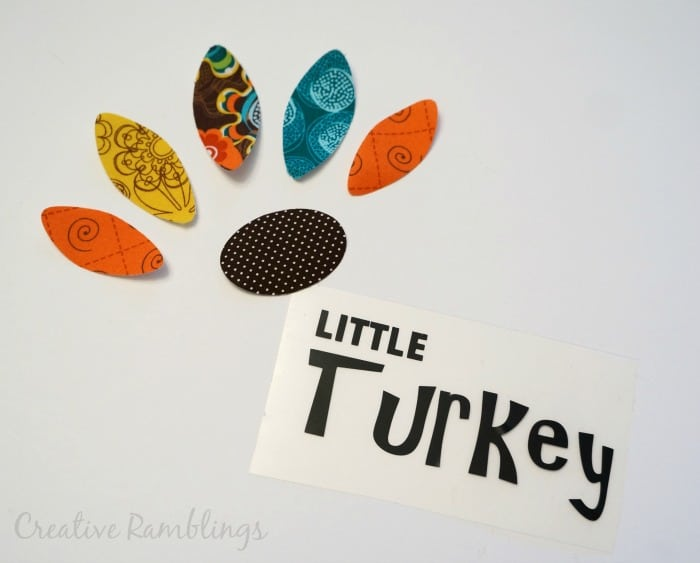 turkey onesie with fabric feathers and htv words