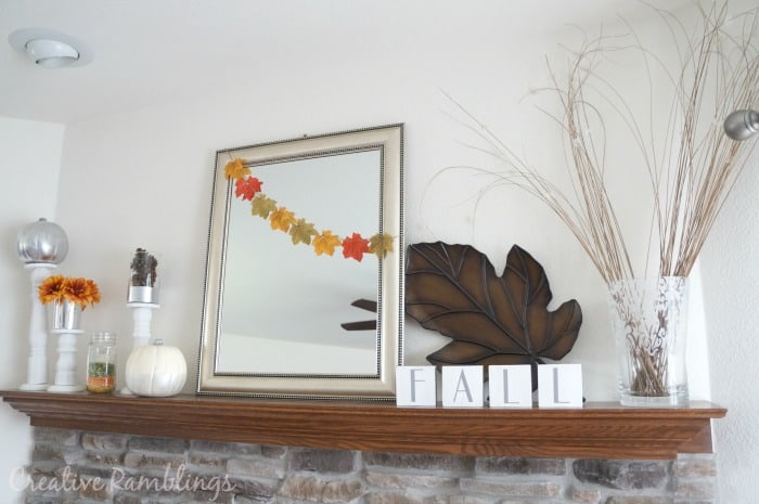 Fall mantle with Dollar Tree leaf garland #DTAnniversary #ad