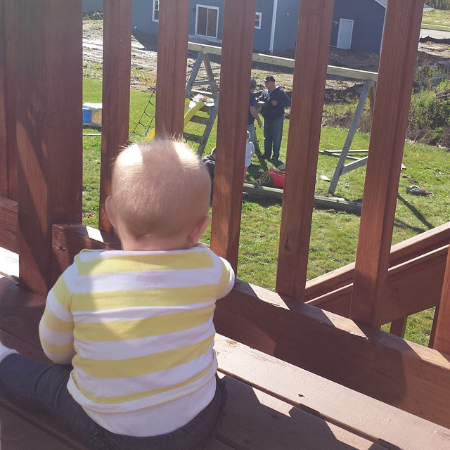 Watching excitedly as Grandpa, Uncle, Big Sister & Dad put up her swingset. #saturday #outside #play