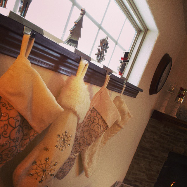 Stocking were hung {next to} the chimney with care. Because last year they were just a little to close to the flame for comfort.  #safetyfirst #christmas #stockings