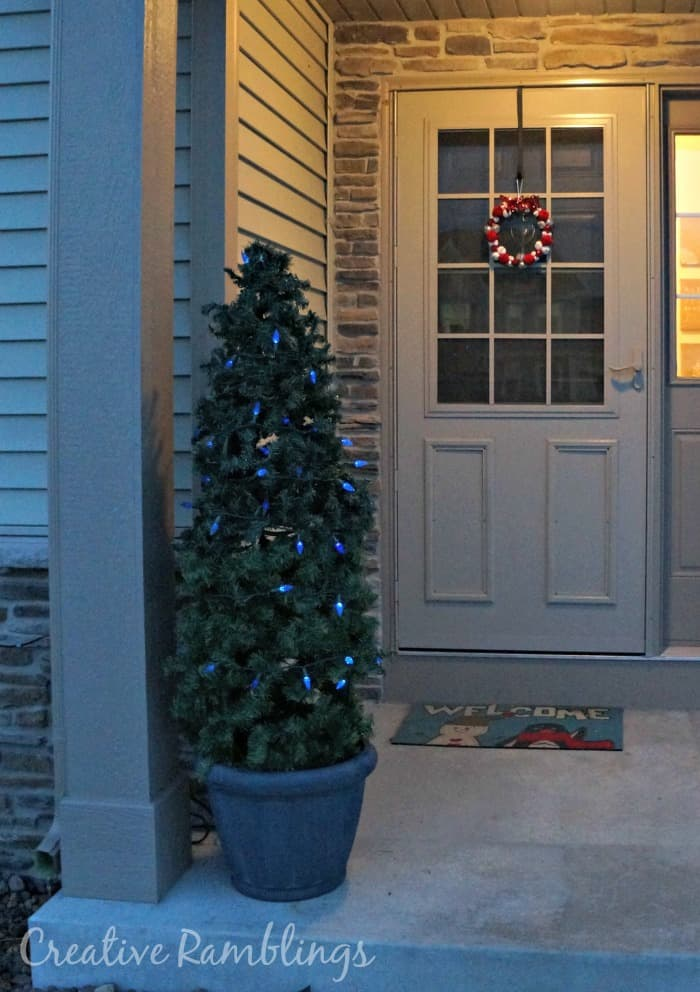 faux evergreen topiary for a winter porch