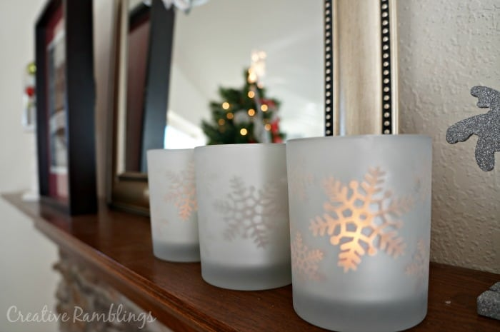 Snowflake luminaries on a Christmas mantle
