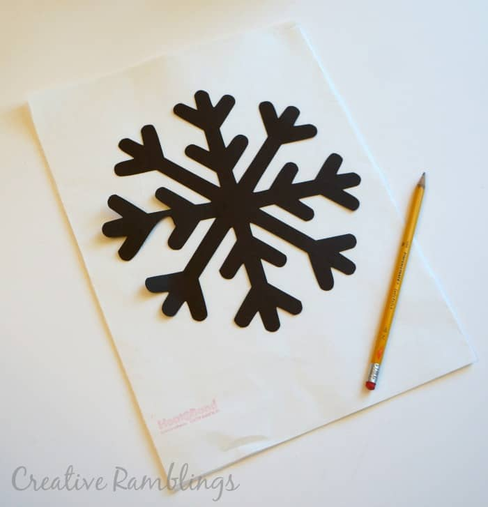 trace a snowflake onto felt for a no sew winter pillow