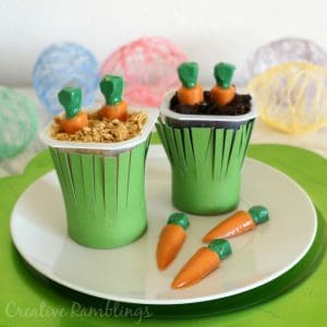 Easter carrot garden pudding cups made with Snack Pack Pudding cups, Oreos, Graham crackers, and candy carrots.