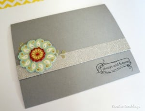 Tri fold handmade wedding card. Love the silver glitter on the front and pretty flower.