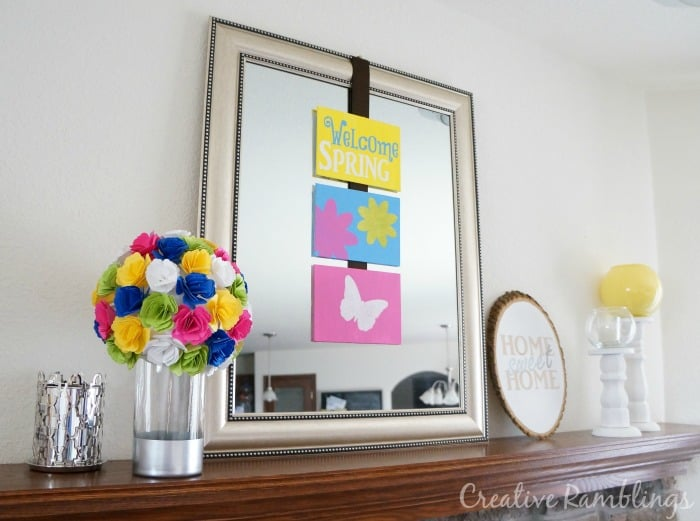 Bright spring mantle with stenciled canvas and flower topiary