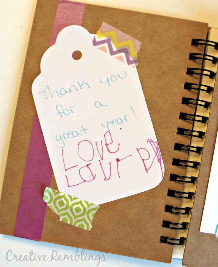 A handwritten tag in a personalized teacher notebook gift.