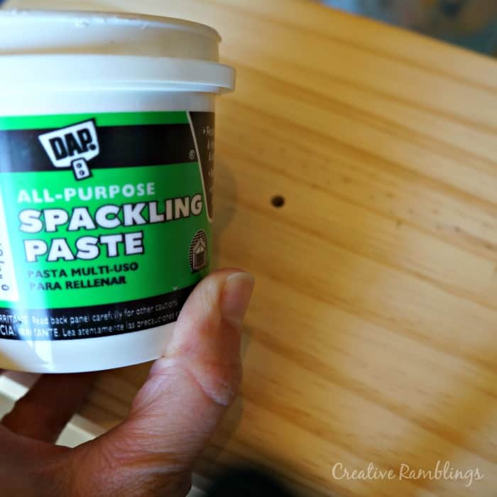 Use spackle to fill in existing holes then sand to a smooth finish.