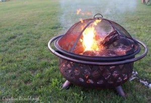 A fire is a simple way to entertain guests at a Labor Day party. #LoveAmericanHome #ad