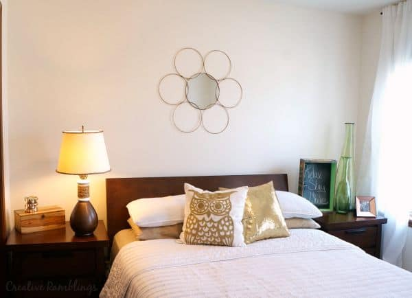 White and metallic guest room and bronze lamp makeover with rustic rope accent