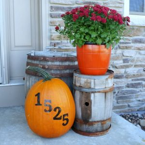 Paint your address on a pumpkin to decorate your front porch for fall