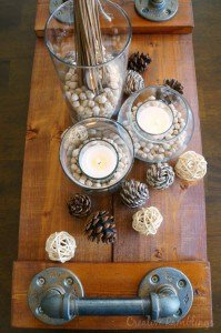 Warm and neutral fall centerpiece on a wood plank tray