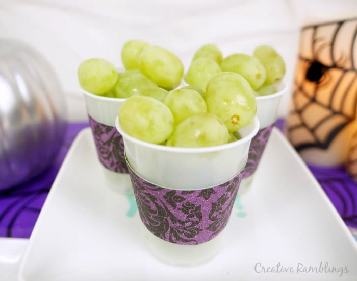 Halloween party for little ones, serve grapes in decorated cups. Perfect for little hands.