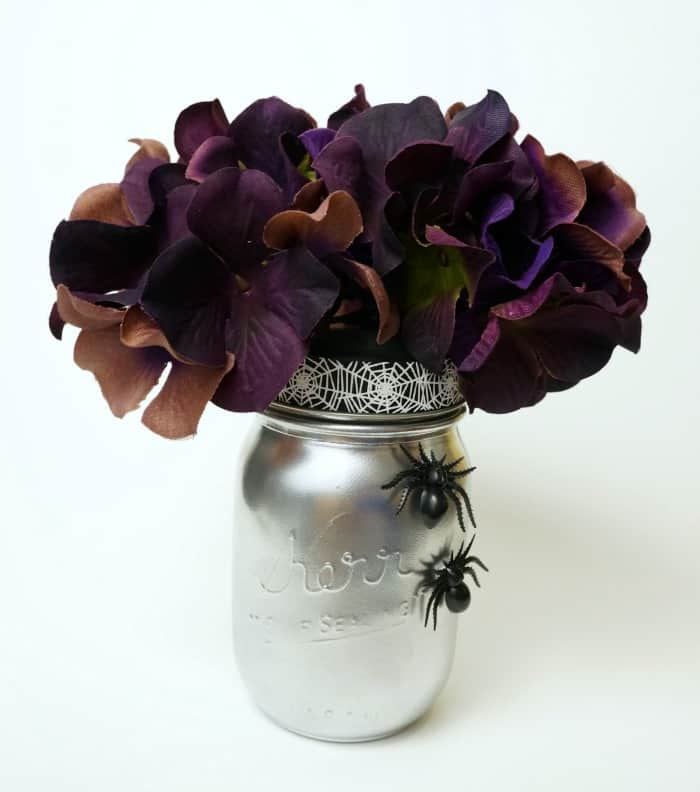 Spooky Halloween mason jar vase. Simple and elegant with a few spooky spiders.