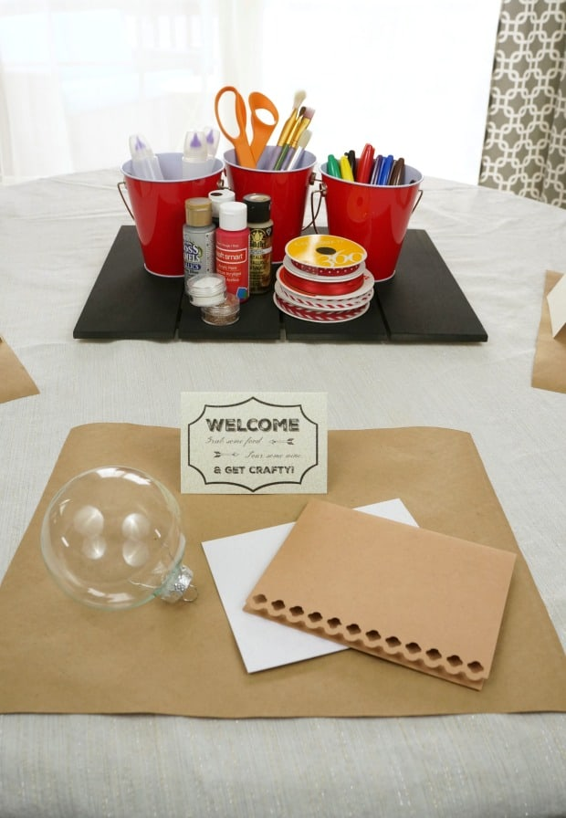 Msg 4 21+ Set a holiday craft party table using kraft paper placemats and a variety of craft supplies for guests to use. #HolidayPairings #ad