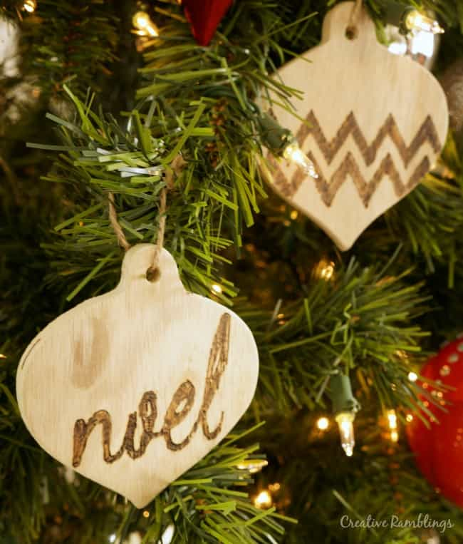 Yes you can create these easy wood burned ornaments, 1 simple tool and a few easy steps. Pin this now and save it for Christmas.
