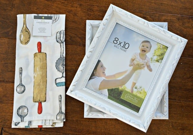 Use a kitchen towel to create pretty framed art for your kitchen