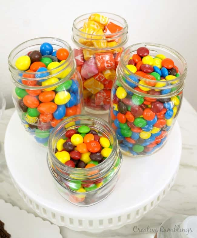 A sweet Super Bowl party spread with mason jars of candy AD #SweetenTheSpread