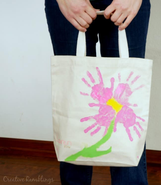 This hand print flower tote bag is a fun project to do with kids and make an adorable keepsake gift