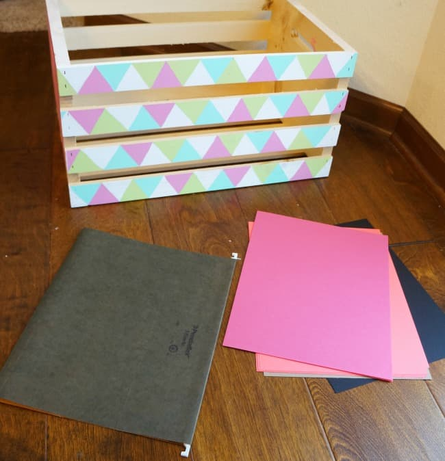 Organize paper in a wood crate
