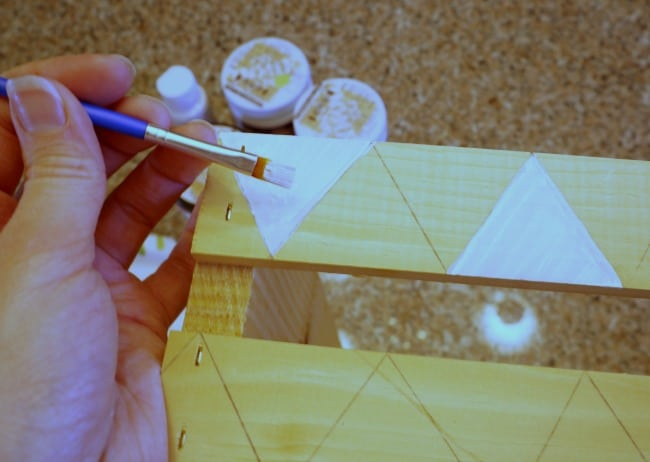 Paint a geometric pattern on a wood crate and use it for scrapbook paper storage