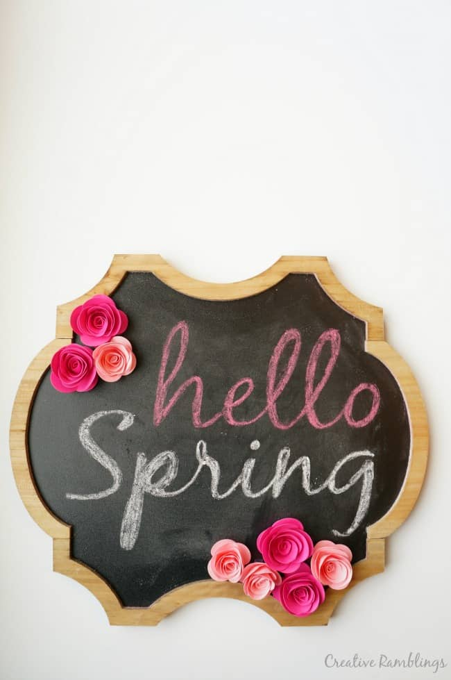 Welcome Spring with a chalkboard sign and Silhouette rolled paper flowers