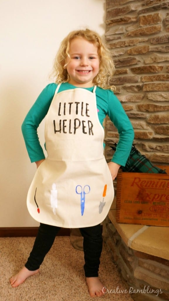 A stenciled kids apron for a little helper made with a Silhouette and freezer paper.
