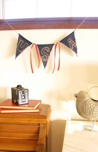 Make this vintage looking patriotic banner with fabric and a bleach pen.