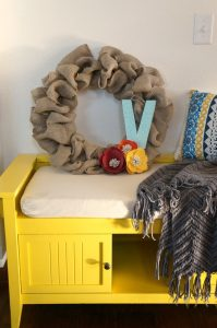 colorful foyer bench and wreath