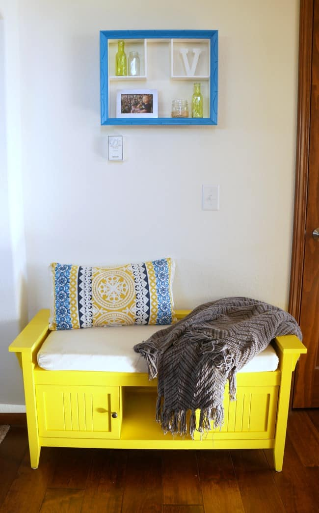 Colorful foyer bench in bright yellow