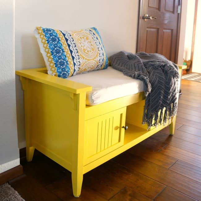 cozy colorful foyer bench in yellow