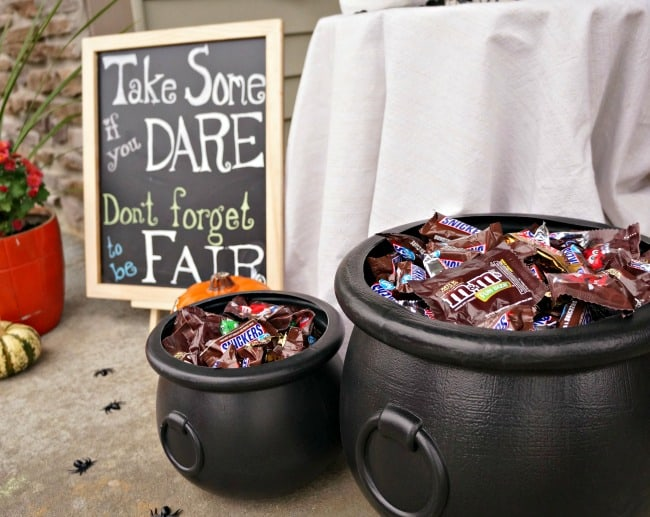Halloween porch with candy cauldrons for trick or treat