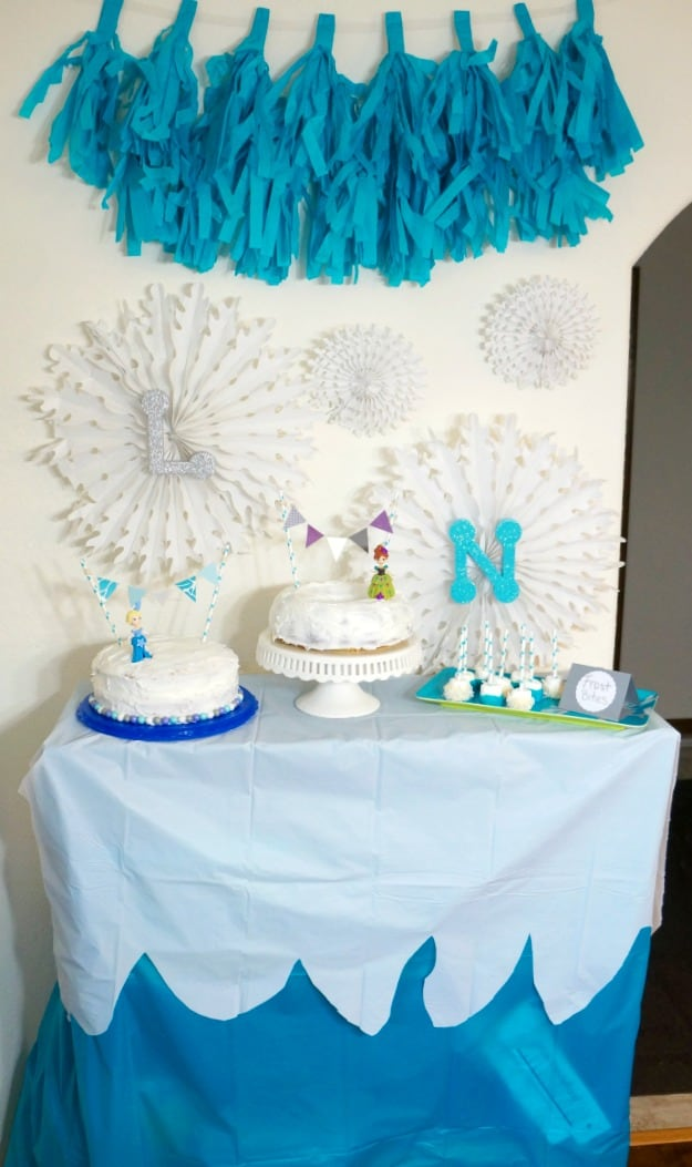 A frozen party dessert table with DIY decorations