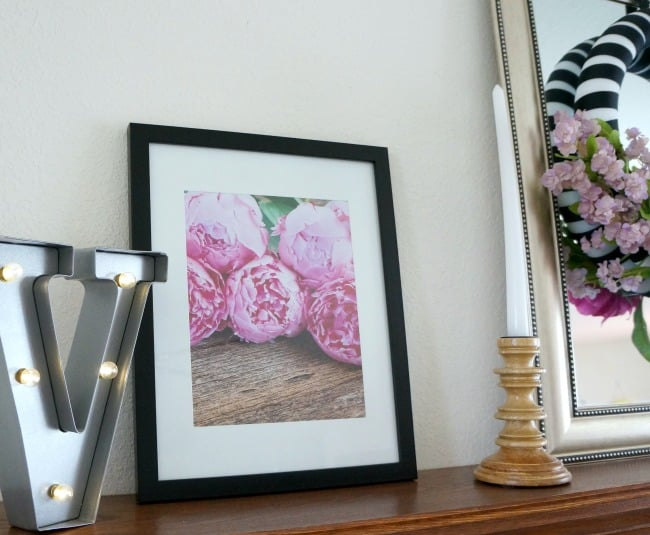 Pink black and white mantle with framed peonies