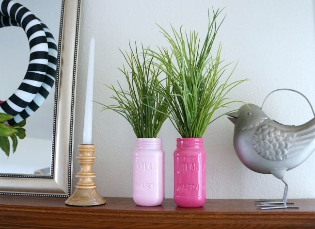 Pink black and white mantle with painted mason jars