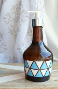 Upcycle a bottle to make this glass jar soap dispenser with easy vinyl decals