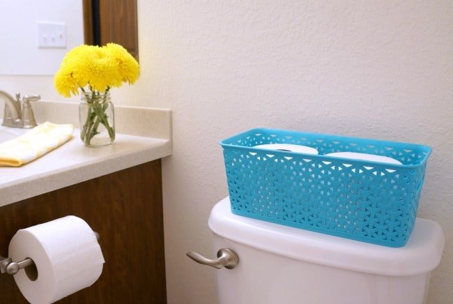 Colorful bathroom refresh with bin for Quilted Northern® Mega Rolls
