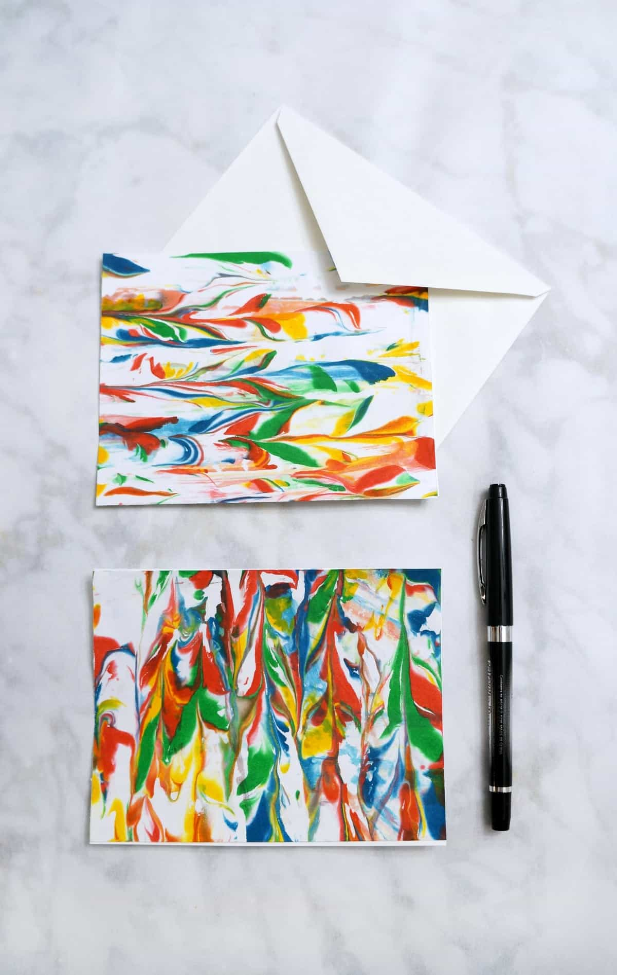 Marbled Paper cards. Easily marble paper using a few simple supplies and create a custom stationery gift set.