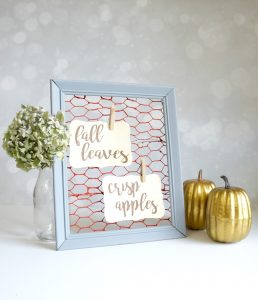 Faux chicken wire frame for fall with clothespins and messages for the season.