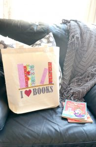 Make a library book bag for kids or adults using fabric and heat transfer vinyl. Get all the details here.