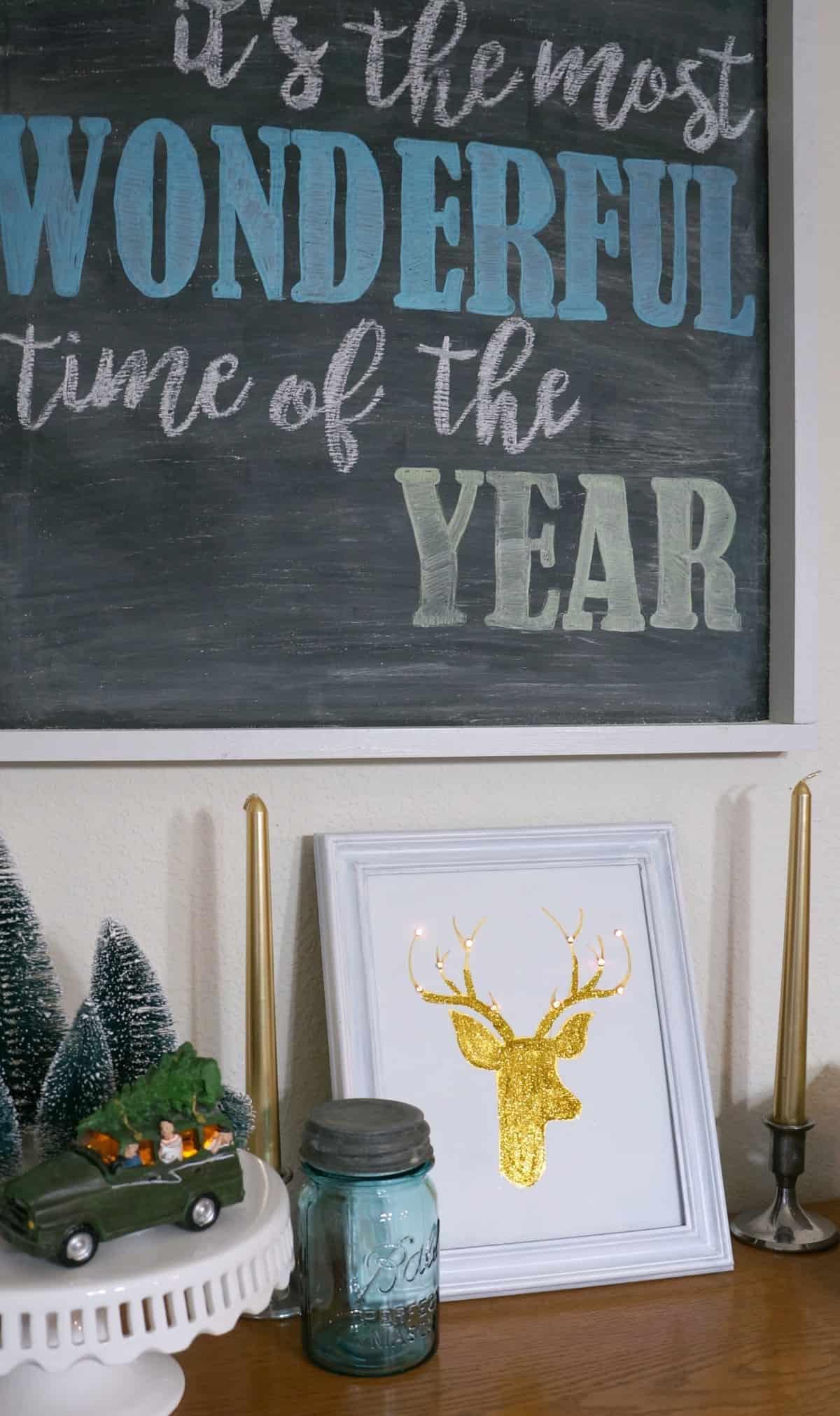 DIY Christmas Reindeer Art with lights and lots of colorful christmas decor