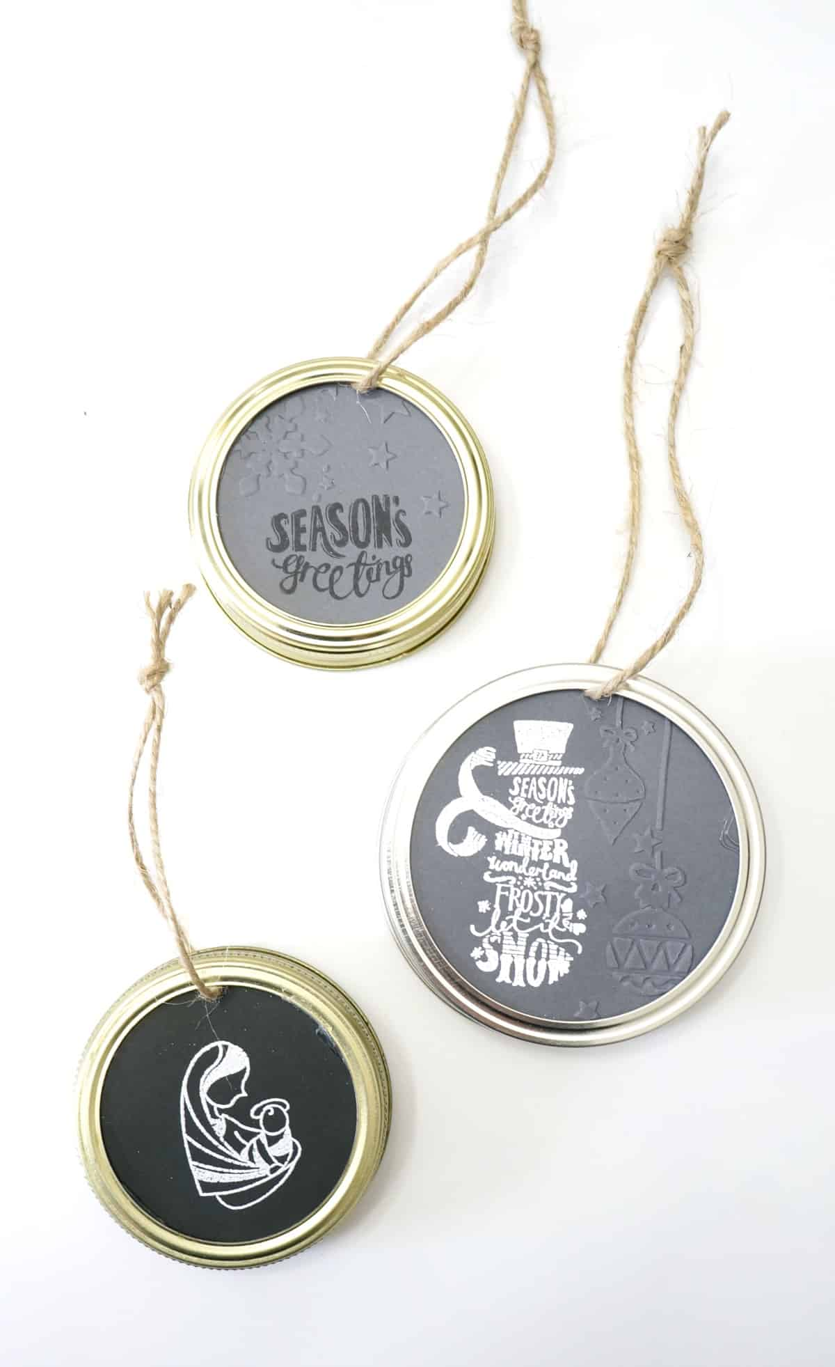 Make these mason jar lid ornaments using stamps and embossing folders