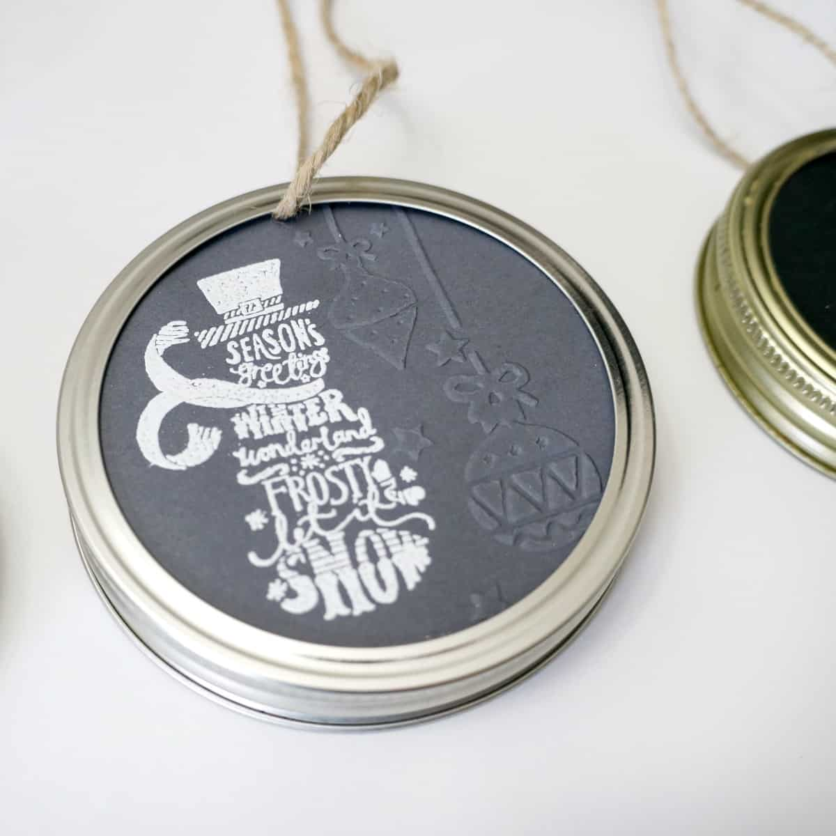 Mason jar lid ornament with paper and stamps