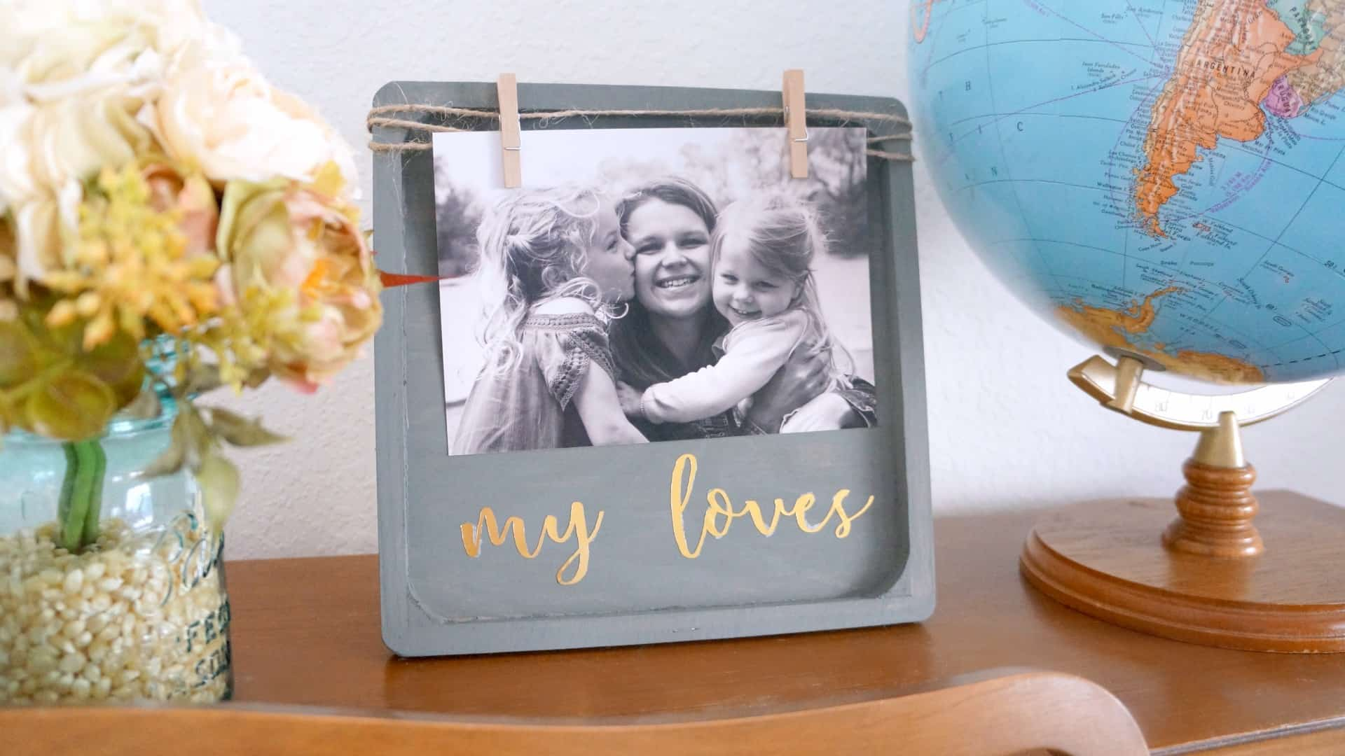 Gray and gold wood clothes frame